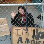 Press Release: Occupier Scales Chain Link Fence to Protest City's Lack of Action on Homelessness